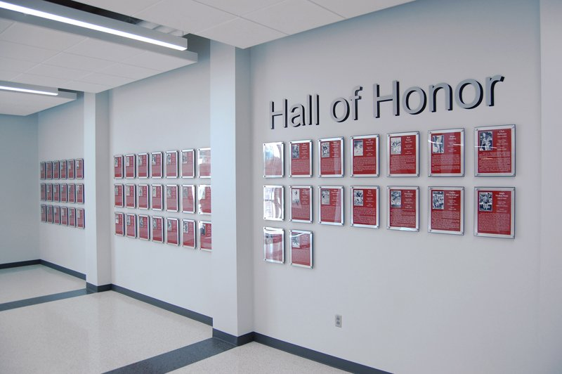 Central College Hall of Honor hallway with aluminum lettering and red plaques