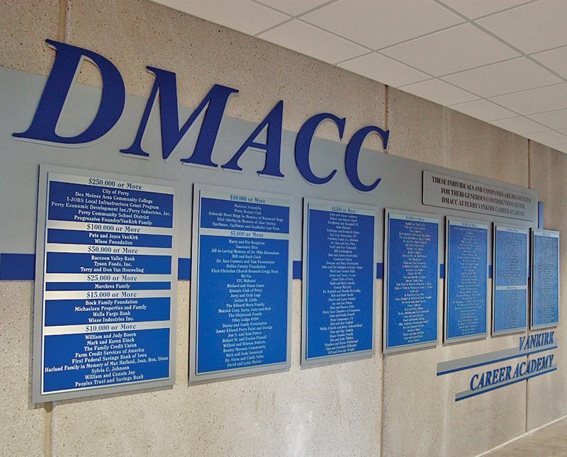DMACC donor wall with blue and silver aluminum lettering and zinc plaques