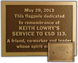A bronze plaque with inset view of welded studs on back for easy mounting.