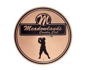 Circular, copper Meadowlands Country Club plaque with golfer logo