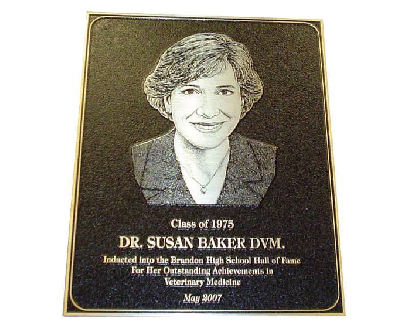 Black plaque with pebbled texture and drawing of Dr. Susan Baker