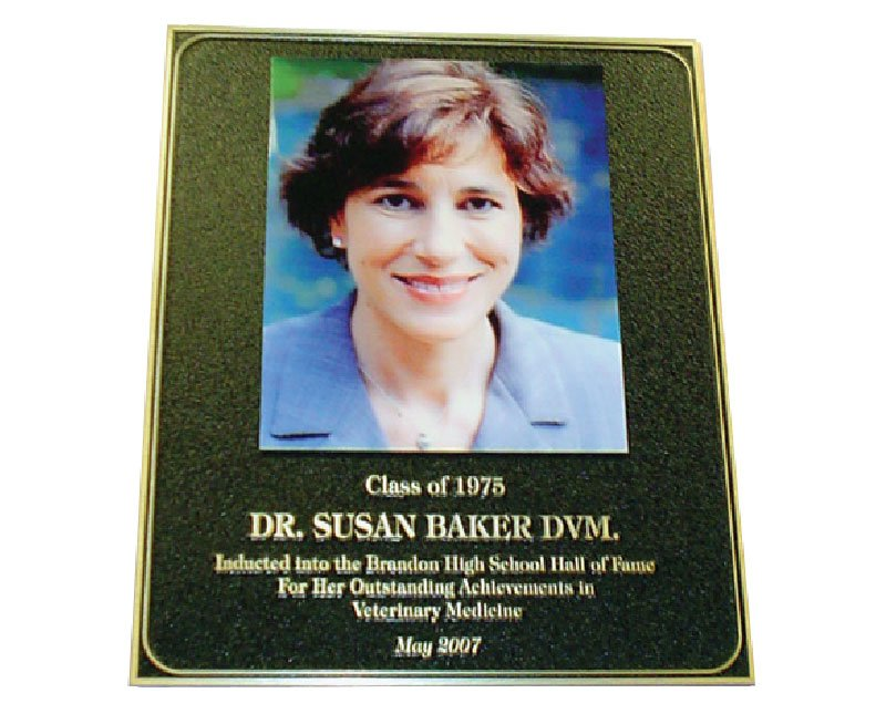 Black plaque with pebbled texture and UV-printed color image of Dr. Susan Baker