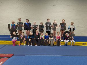 Gymnasts-with-sign-letters