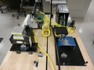 Metal asset tag finishing and corner cutting equipment
