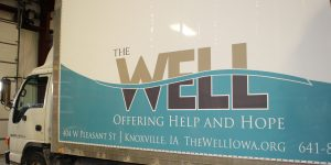 The Well partial box truck wrap