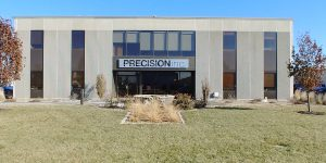 Precision, Inc., wall-mounted sign