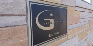 The Identity Group wall-mounted sign