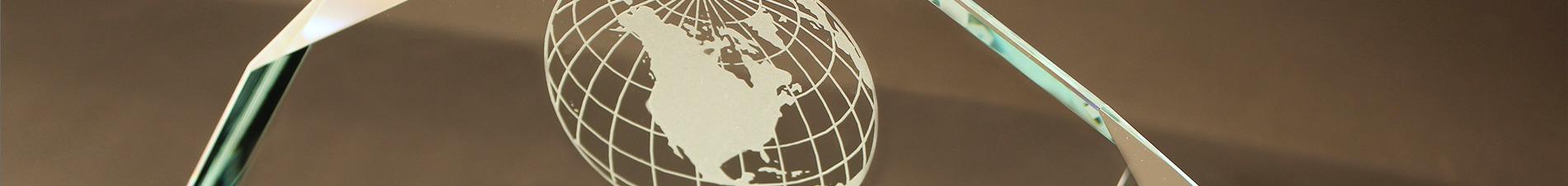 Header image closeup of sandcarved award with globe