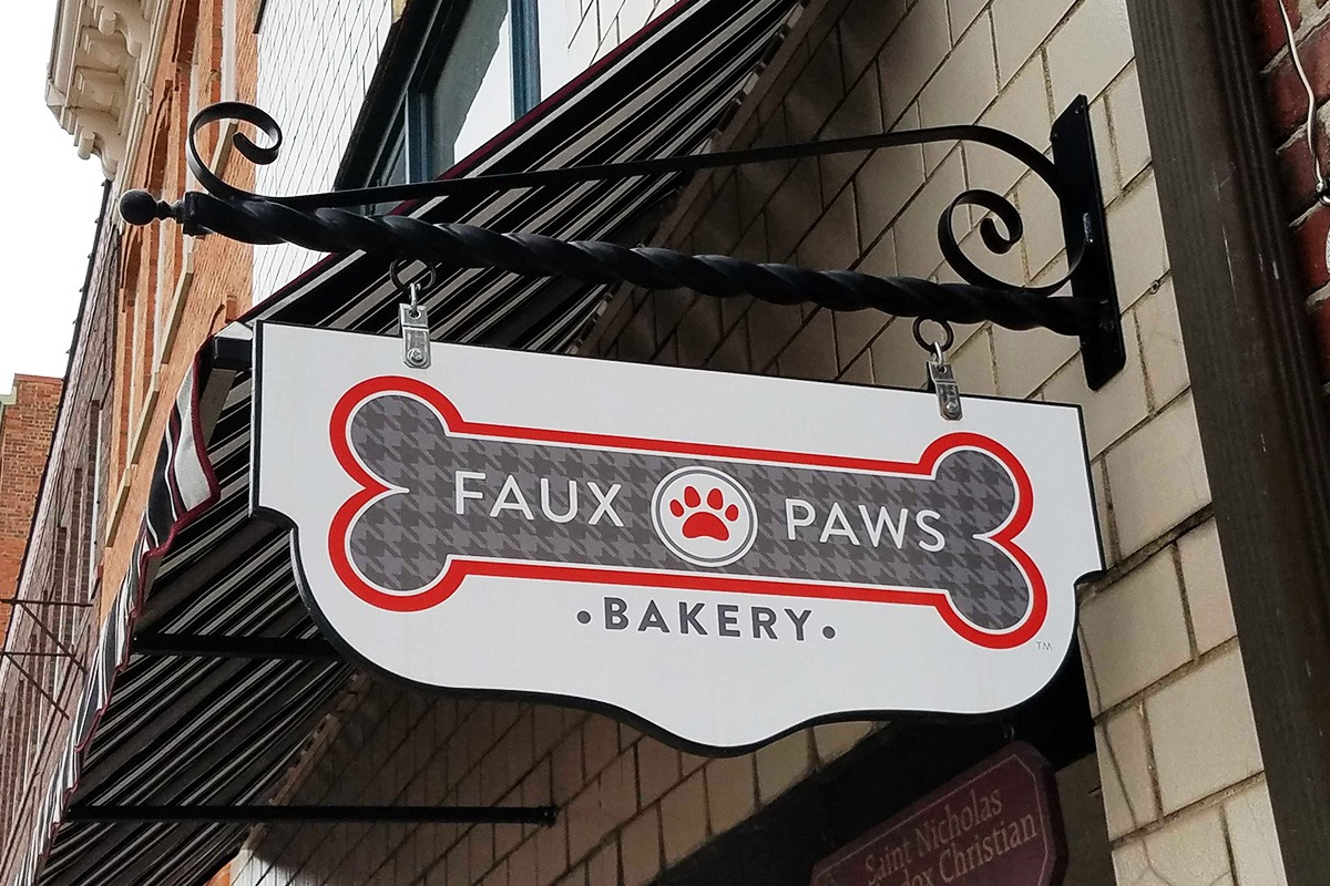 wall-mounted-storefront-hanging-signage-faux-paws