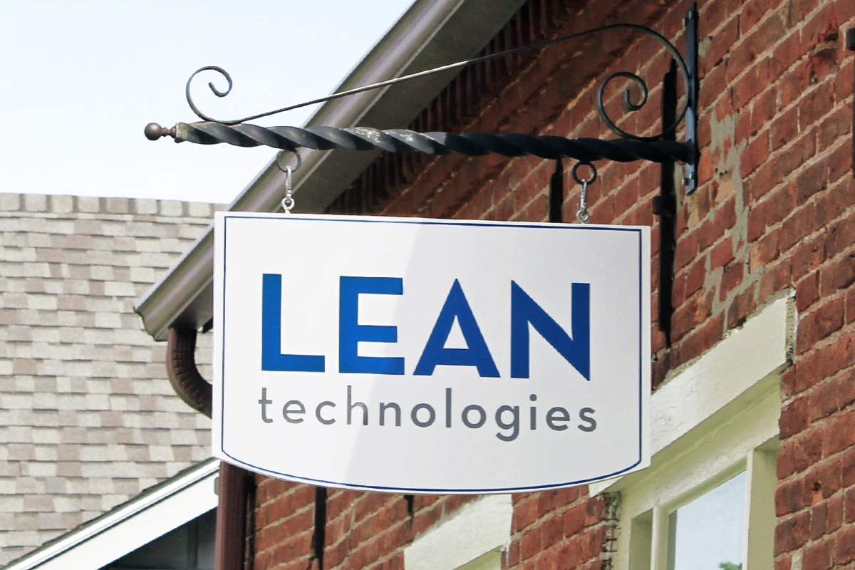 wall-mounted-storefront-hanging-signage-lean-tech