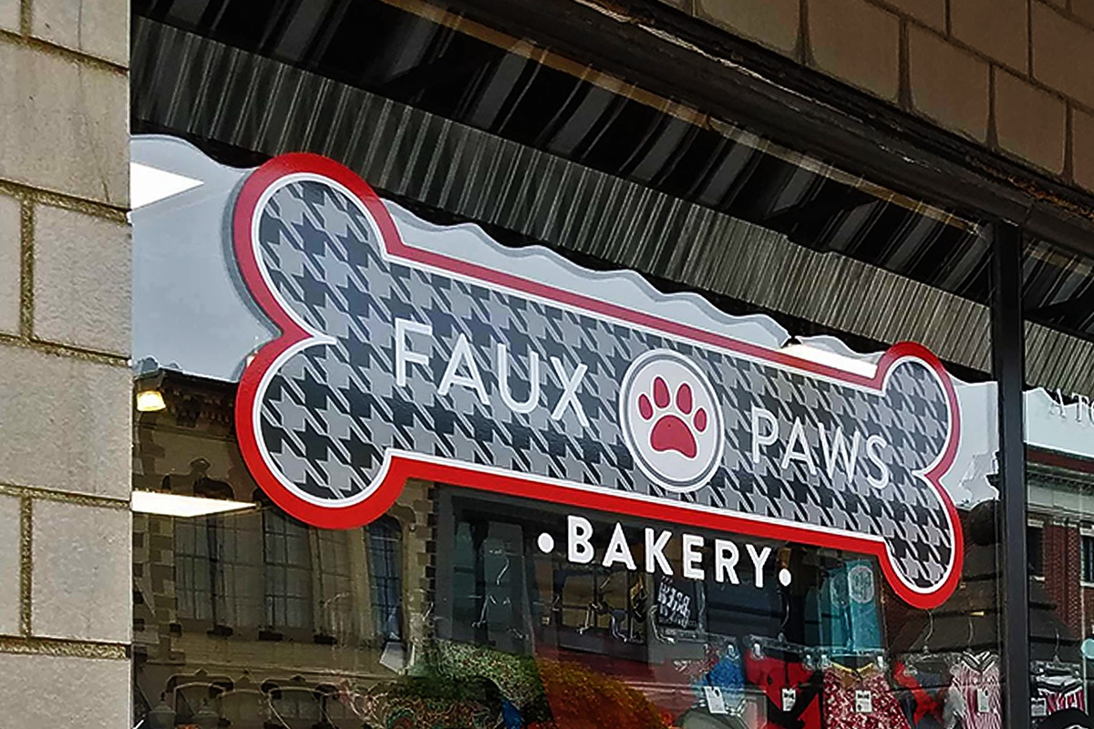wall-mounted-storefront-signage-vinyl-faux-paws