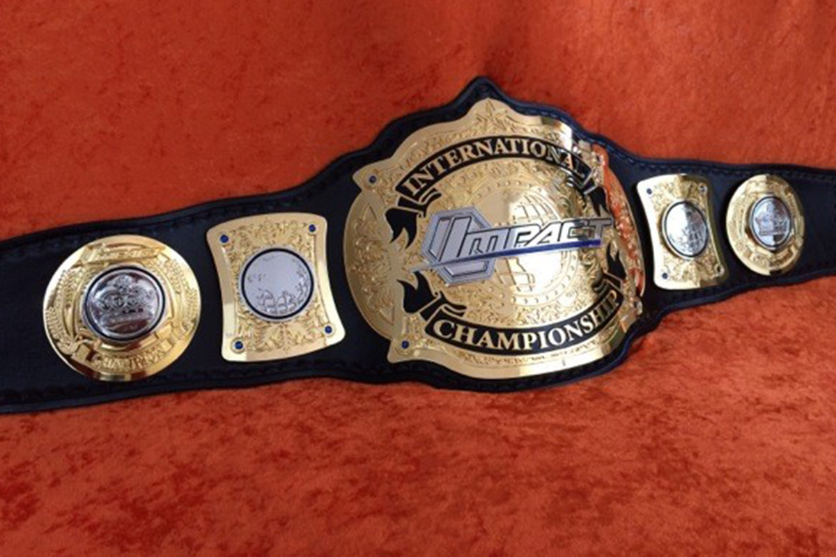 Zinc and leather etched Wilcat wrestling champion belt