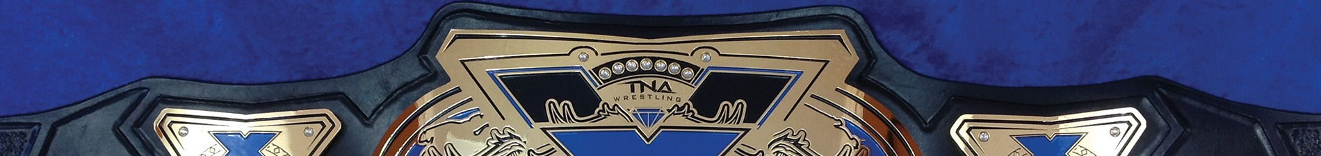 Header image closeup of leather and etched zinc championship belt with blue color-filling