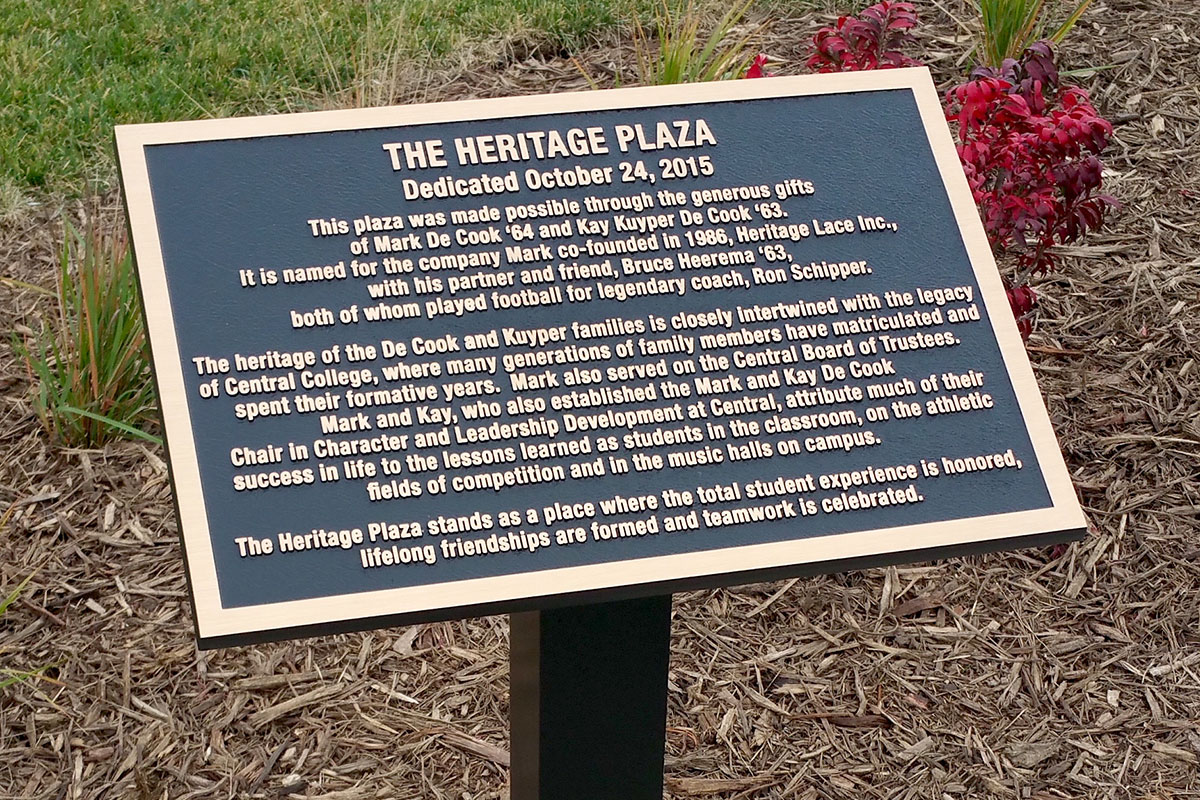 Black and bronze Heritage Plaza plaque mounted on garden stake