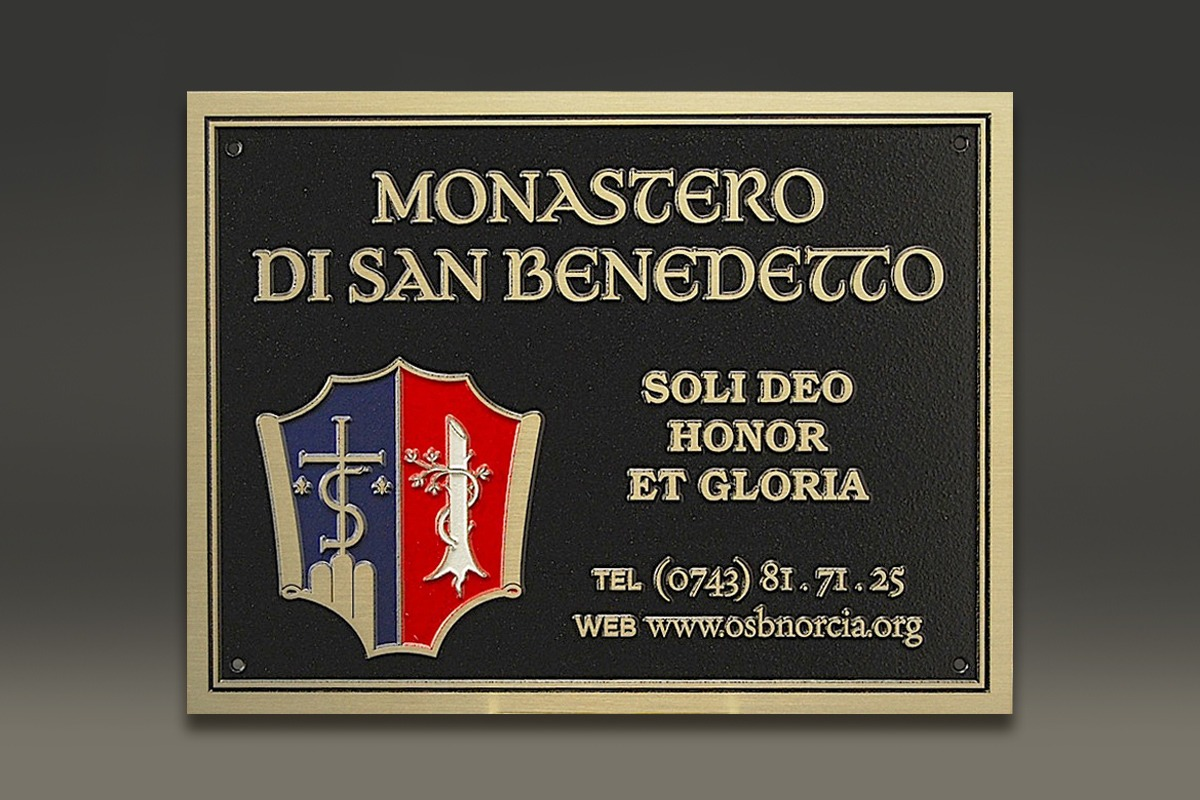 Black magnesium Monastero di San Benedetto plaque with color-filled seal