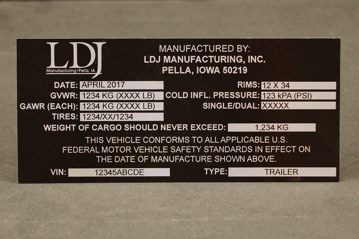 Black and silver Metalphoto LDJ serial tag
