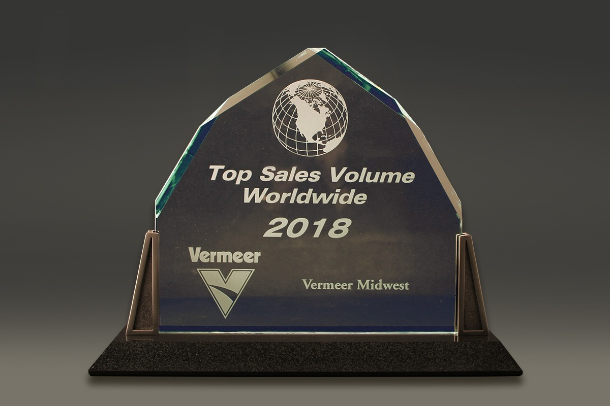 Diamond-shaped corporate award with Vermeer logo and globe