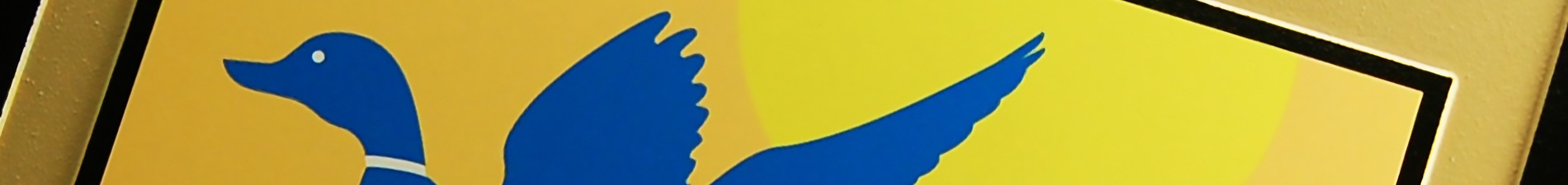 Header image closeup of plaque with UV-printed, blue and yellow seal of U.S. Fish & Wildlife Service