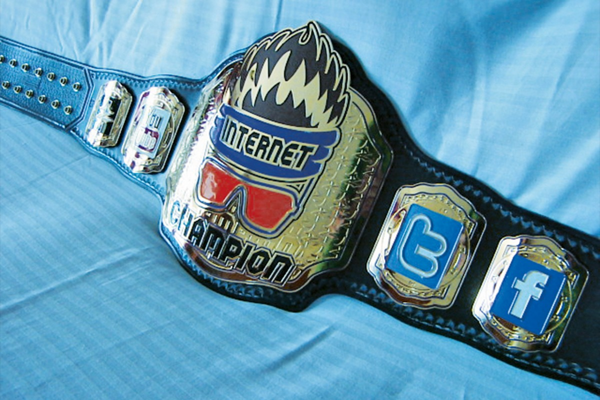 Leather and etched zinc Internet Champion belt with color-filled social media icon panels