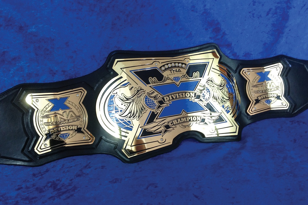 Leather and etched zinc Division X Champion belt with blue accents