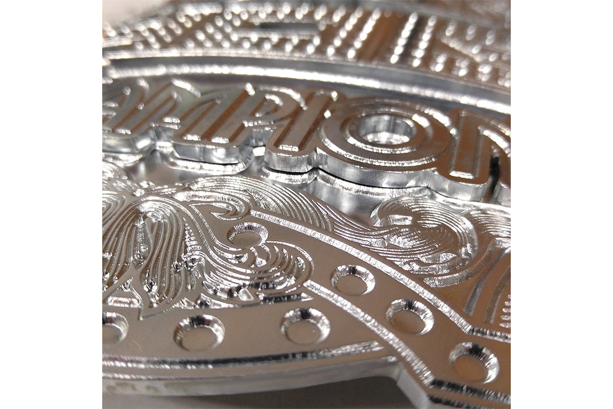 Closeup of etched zinc plate for championship belt