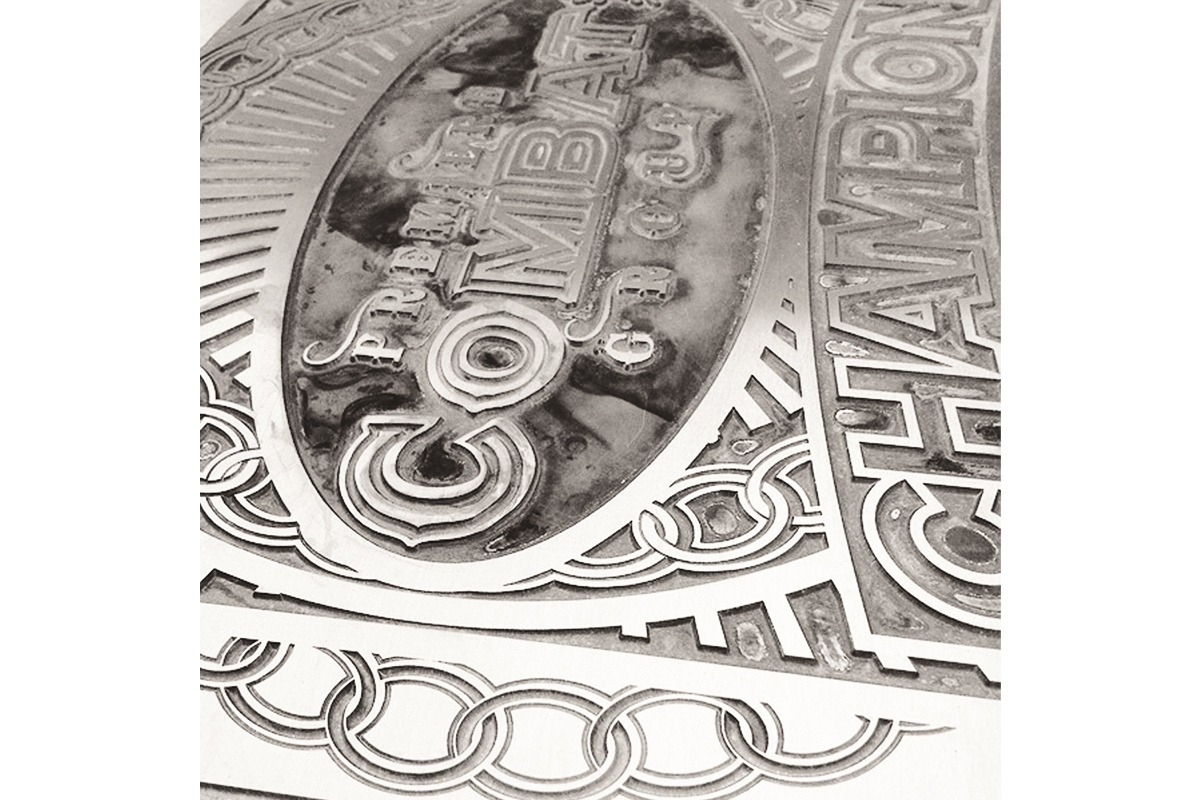 Closeup of etched zinc for Premiere Combat championship belt