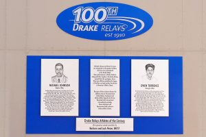 Blue and silver zinc plaque display for 100th Drake Relays