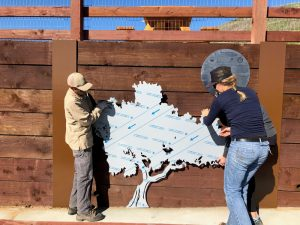 Land Conservancy team members installing the wall.