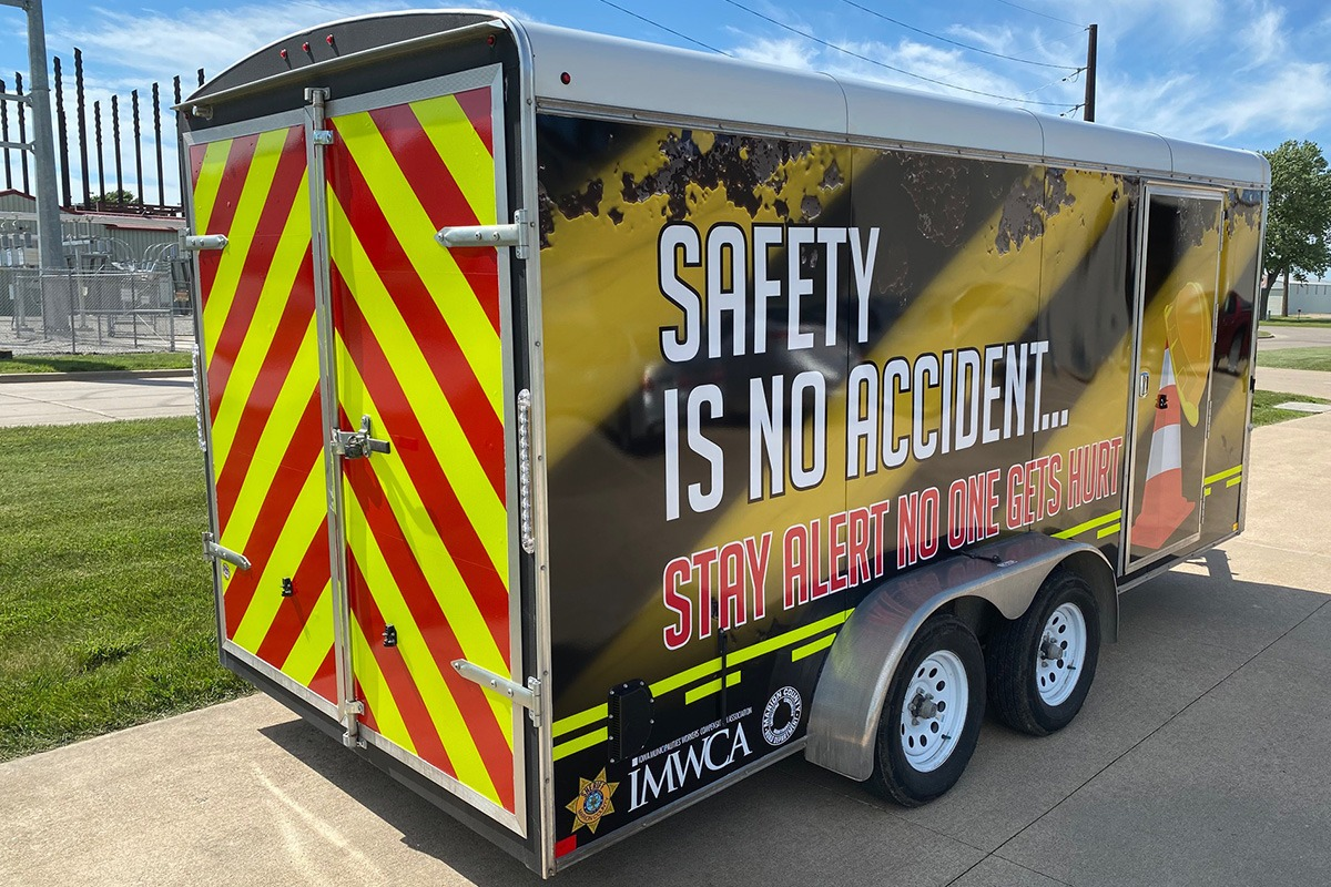 Safety stripes on trailer with safe driving message