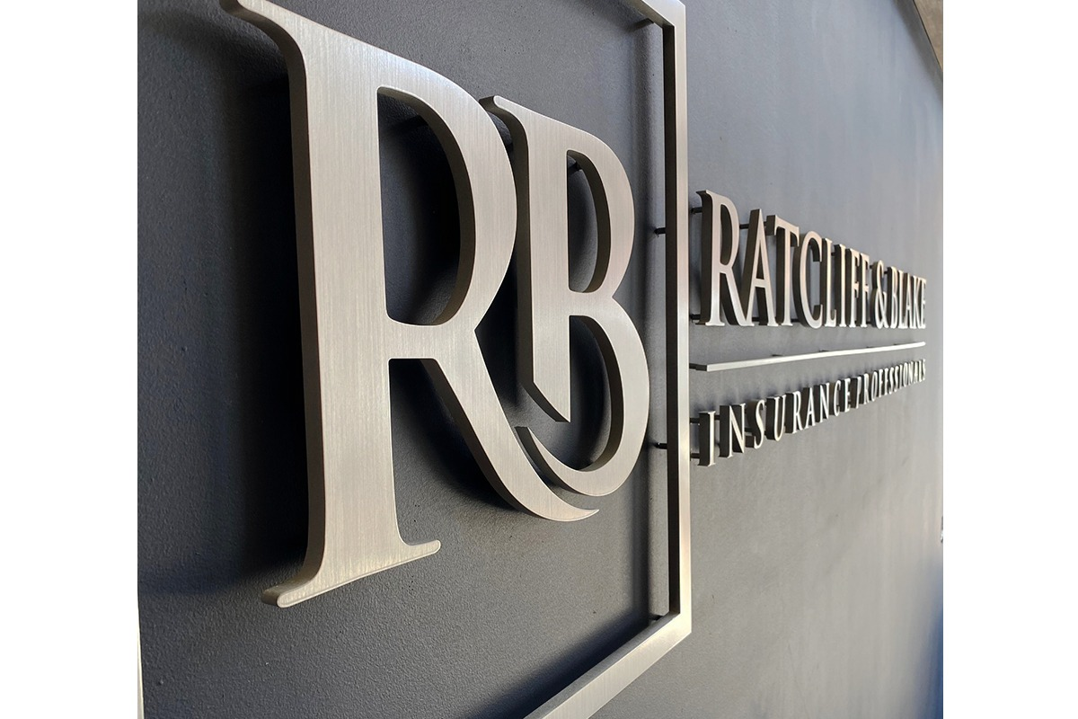 Silver wall-mounted letters for insurance company