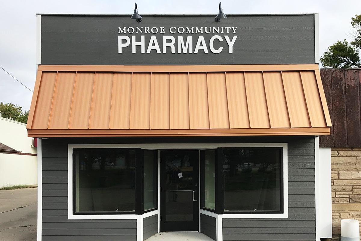 White letters on black building for Monroe Pharmacy
