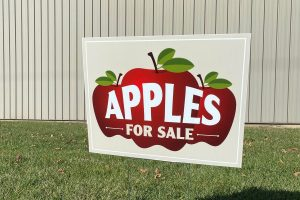 Apples for sale yard sign featuring three red apples