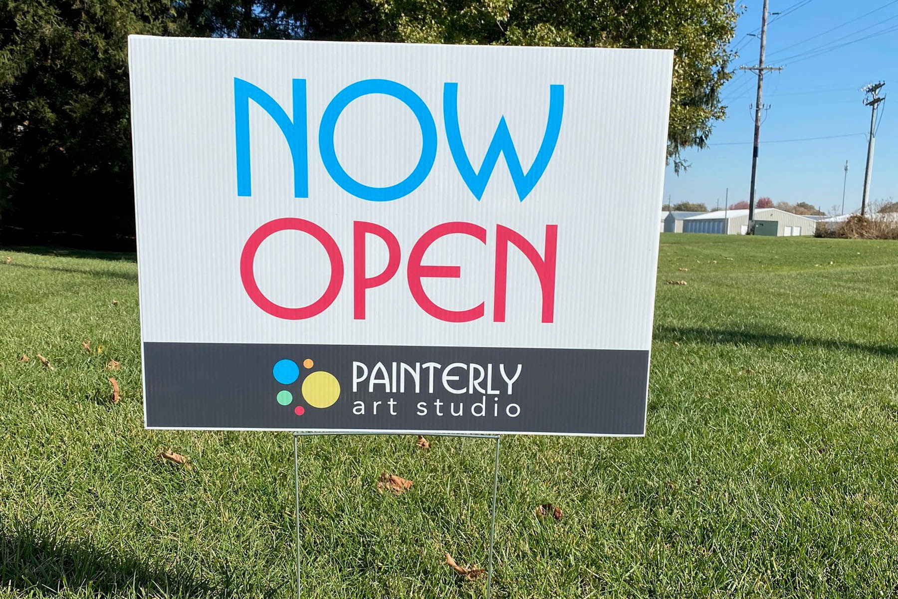 White, blue, and red grand opening yard sign for Painterly Art Studio