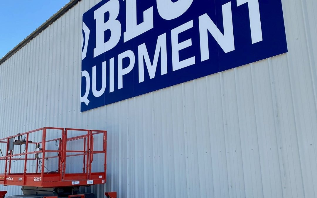 Go big and go blue: PEC fabricates signage for new Kinze Manufacturing dealership