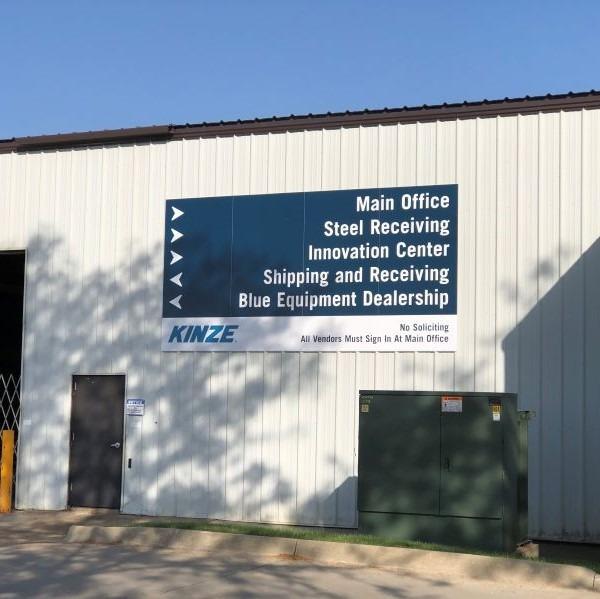 Kinze wayfinding sign installed on building